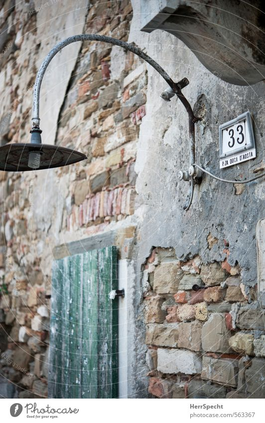 Old House (Residential Structure) Window Building Gray Lamp Brown Facade Gloomy Signs and labeling Closed Esthetic Simple Digits and numbers Historic