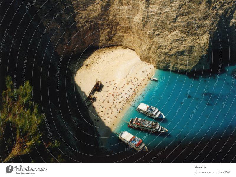 Human being Tree Green Blue Vacation & Travel Greece Sand Watercraft Rock Branch Swimming & Bathing Bay Turquoise Beige Wall of rock Zakynthos