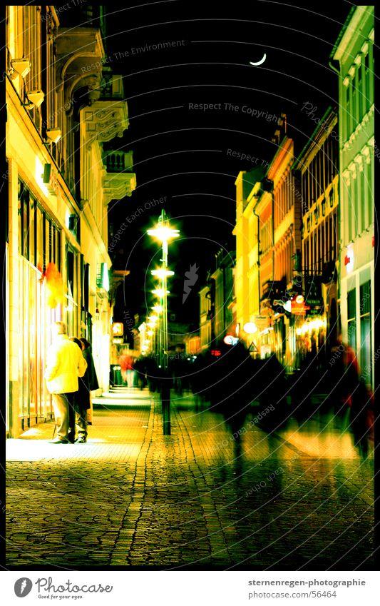 Human being Sky City House (Residential Structure) Movement Lantern Moon Downtown Anonymous Haste Night life Pedestrian precinct Heidelberg Half moon