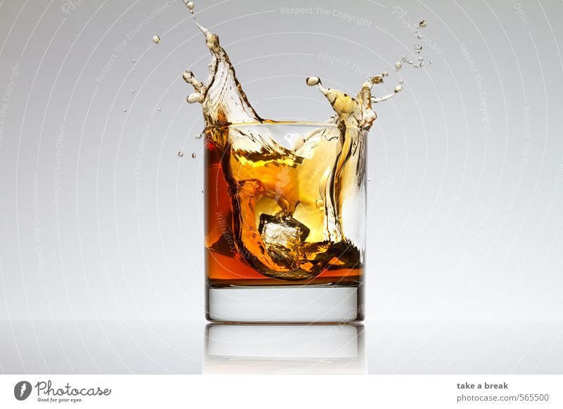 Splashes in glass Food Beverage Cold drink Hot drink Lemonade Juice Tea Alcoholic drinks Spirits Glass Water Brown Yellow Orange Colour photo Studio shot