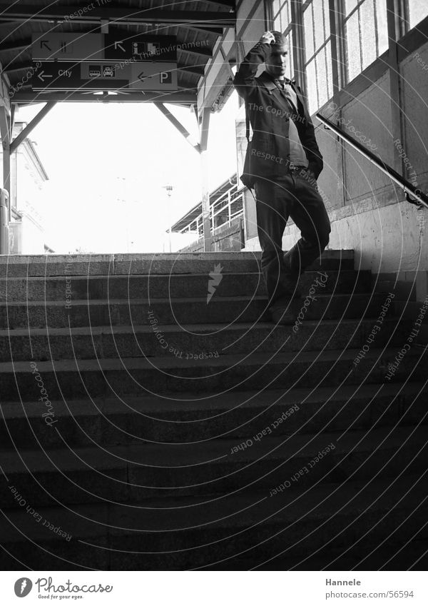 Human being Man White Black Railroad Stairs Jeans Railroad tracks Jacket Train station Clothing Underpass