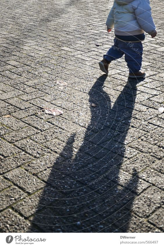 Human being Child City Sun Winter Street Playing Gray Stone Healthy Going Horizon Masculine Contentment Walking Places