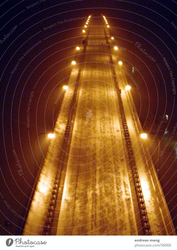 Far-off places Street Dark Snow Bright Lighting Bridge Long Street lighting