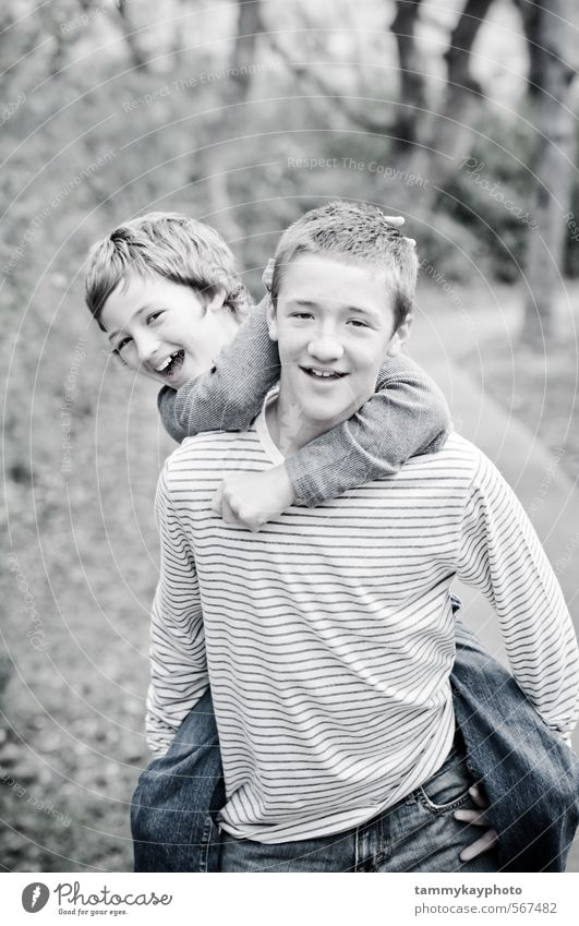 Cute brothers laughing giving piggyback ride Human being Child Nature Youth (Young adults) Beautiful White Landscape Joy Young man Love Boy (child) Playing Laughter Fashion Friendship Together