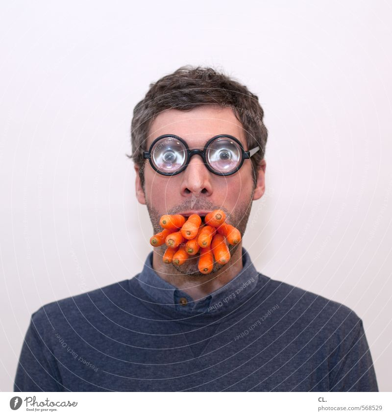 Human being Man Face Adults Eyes Funny Eating Head Food Orange Masculine Mouth Nutrition Eyeglasses Uniqueness Creativity
