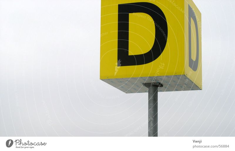 Thick D Letters (alphabet) Yellow Signs and labeling Airport