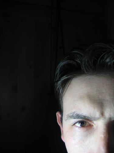 face Close-up black background mistery eye Style sight Dramatic