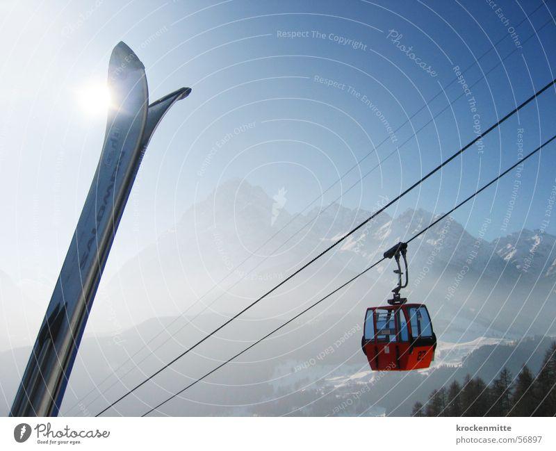 summit Winter vacation Back-light Ski tip Wire cable Mountain range Winter sports Gondola Upward Skyward Sunlight Haze Alpine Diagonal Steel cable
