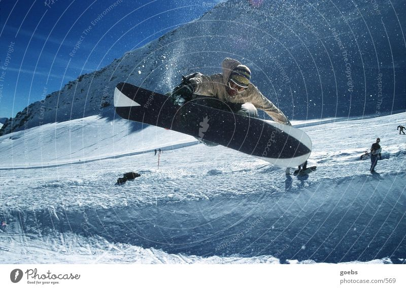 Beautiful Winter Mountain Snow Sports Jump Tall Touch Alps Rotate Downward Rotate Snowboard Winter vacation Talented Halfpipe