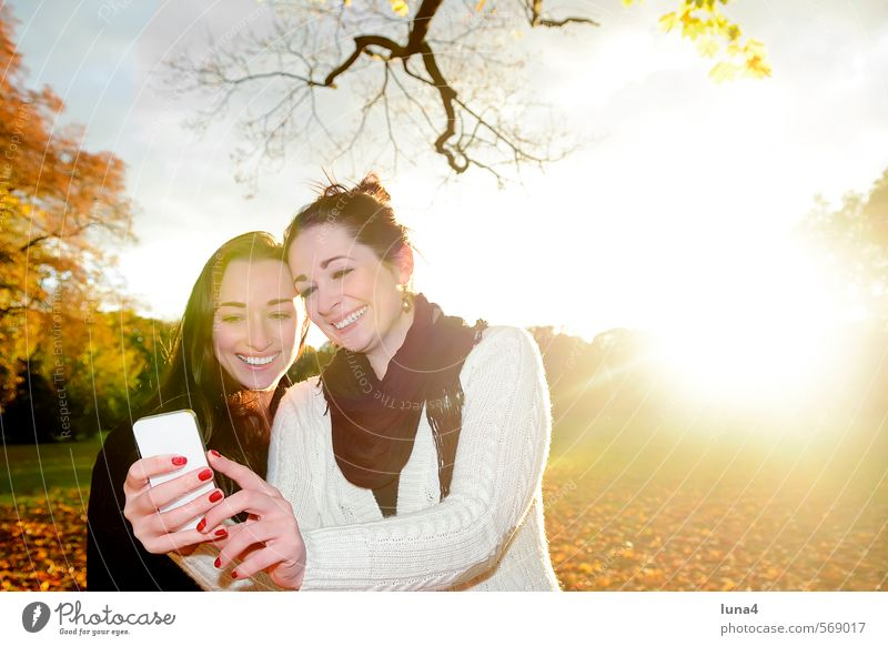self-portrait Joy Happy Sun Telephone Cellphone PDA Information Technology Human being Feminine Young woman Youth (Young adults) Woman Adults