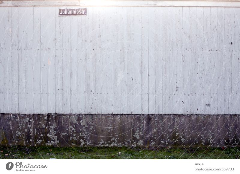 Loneliness Cold Wall (building) Life Street Emotions Wall (barrier) Wood Line Moody Facade Gloomy Signs and labeling Characters Poverty Closed