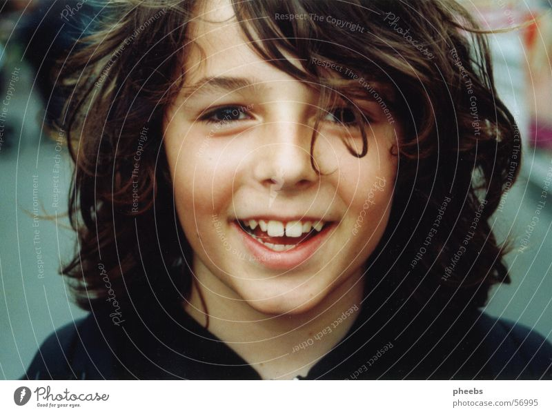 Face Child Boy (child) Laughter Hair and hairstyles Mouth Funny Teeth Lips Portrait photograph Fairs & Carnivals Grinning Curl Hooded sweater