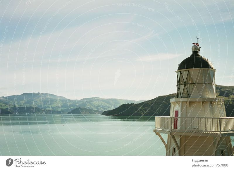 Light at the lake New Zealand Lake Ocean Lighthouse White Loneliness Calm Mountain Tower Blue Smoothness Clarity Water