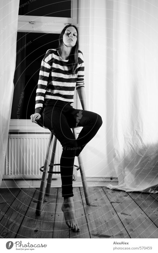 High Young woman Youth (Young adults) Body Legs Feet 18 - 30 years Adults Jeans Striped sweater Barefoot Brunette Long-haired Floorboards Living room Window