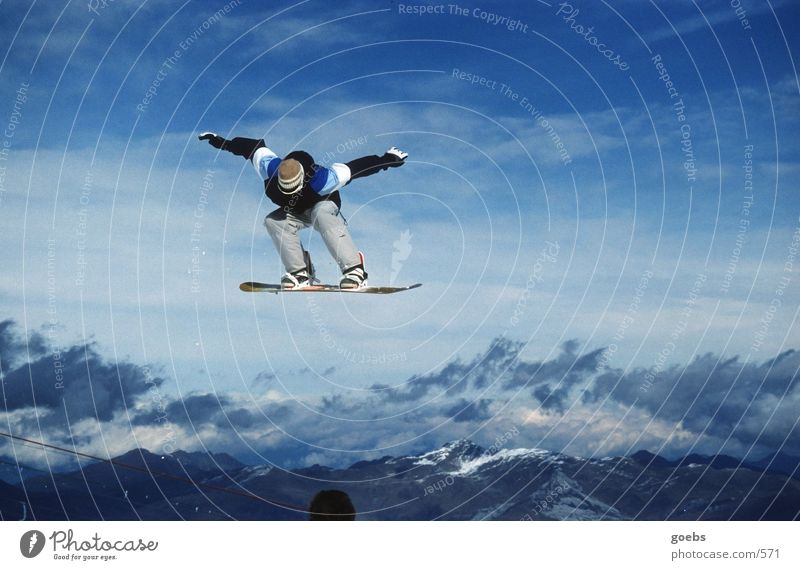 bigair 01 Snowboard Jump Winter Sports Alps Peak Tall Posture Clouds Freestyle Talented Exterior shot Colour photo Snowboarder Snowboarding Air Trick jump