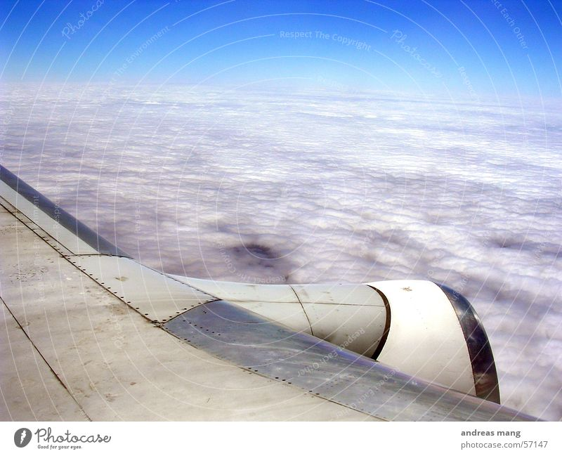 above the clouds Airplane Engines Clouds Cloud cover Horizon Covers (Construction) Sky nozzle Wing Blanket Jet Flying engine aeroplane heaven fly