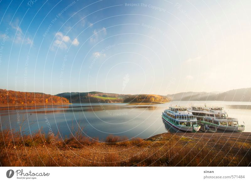 Ships on Lake Bigge in Sauerland Vacation & Travel Sun Mountain Nature Landscape Water Horizon Autumn Weather Tree Forest Inland navigation Watercraft Cold Blue