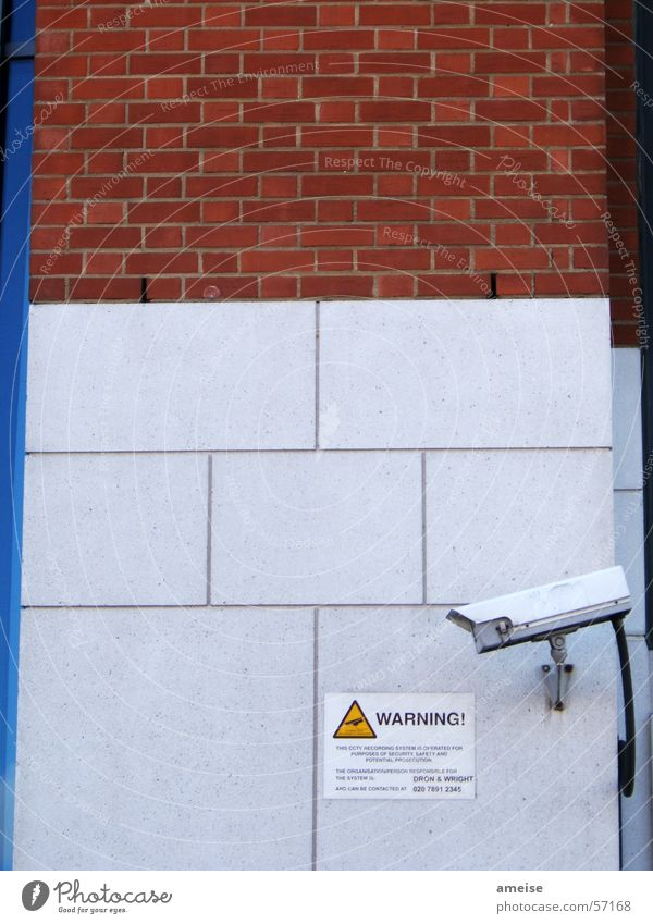 Warning 01 Surveillance Wall (barrier) Tower Bridge Repression Exterior shot Camera Signs and labeling Stone day and night Warning label