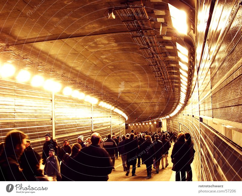 Crowd in the Tiergarten Tunnel Zoo tunnel Town Berlin zoo Underground Dark Concrete Steel Light Capital city Middle Human being Crowd of people Curve Arch