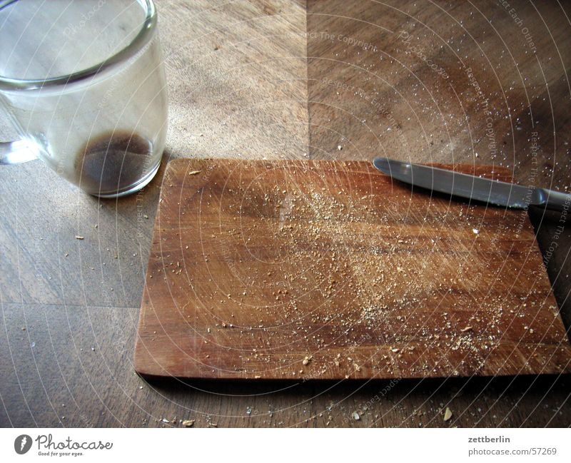Wood Glass Empty Coffee End Breakfast Cup Chopping board Knives Tropic trees Crumbs Coffee grounds