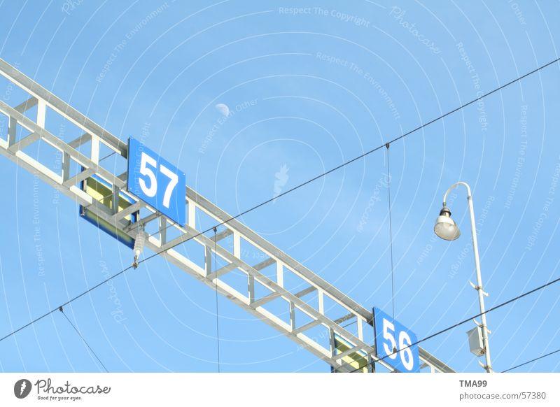 Sky Blue Lamp Railroad Railroad tracks Moon Street lighting Blue sky Overhead line