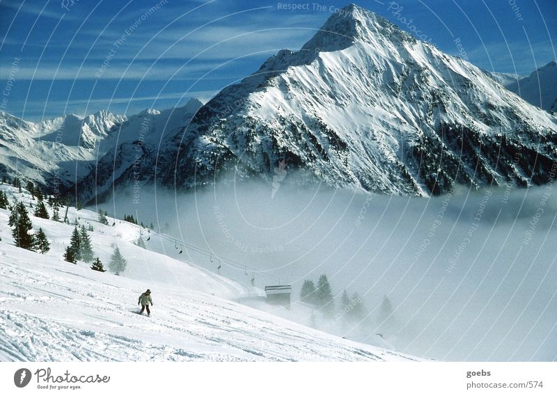 Winter Mountain Snow Sports Fog Alps Snowcapped peak Downward Winter vacation Ski lift Ski run Snowboarding Downward slide Snowboarder