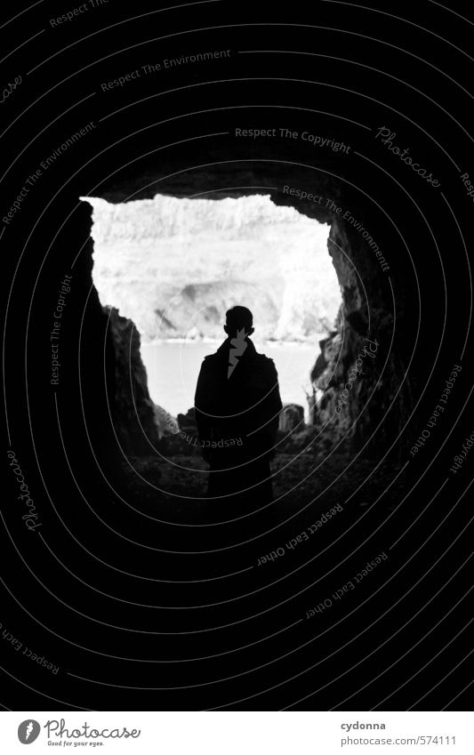 Standing in the dark Human being Man Adults Life Landscape Rock Coast Cave Adventure Stress Loneliness Emotions Mysterious Identity Center point Break Calm