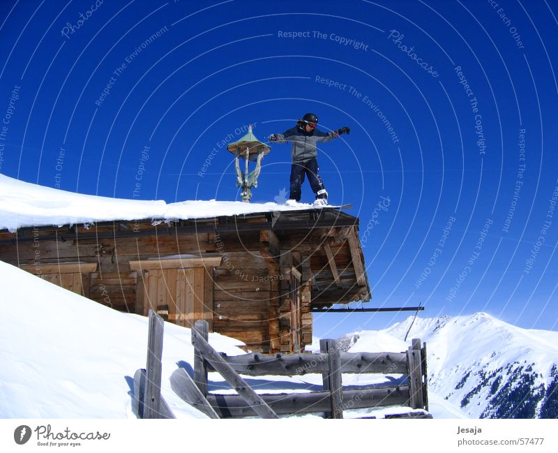 Sky Vacation & Travel Blue House (Residential Structure) Winter Mountain Snow Jump Beautiful weather Roof Hut Cloudless sky Brave Downward Austria Blue sky