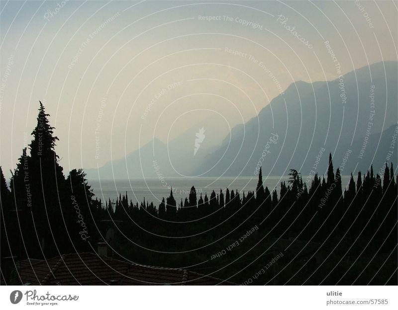Dark prongs Lake Lake Garda Bright Water Blue Mountain Shadow