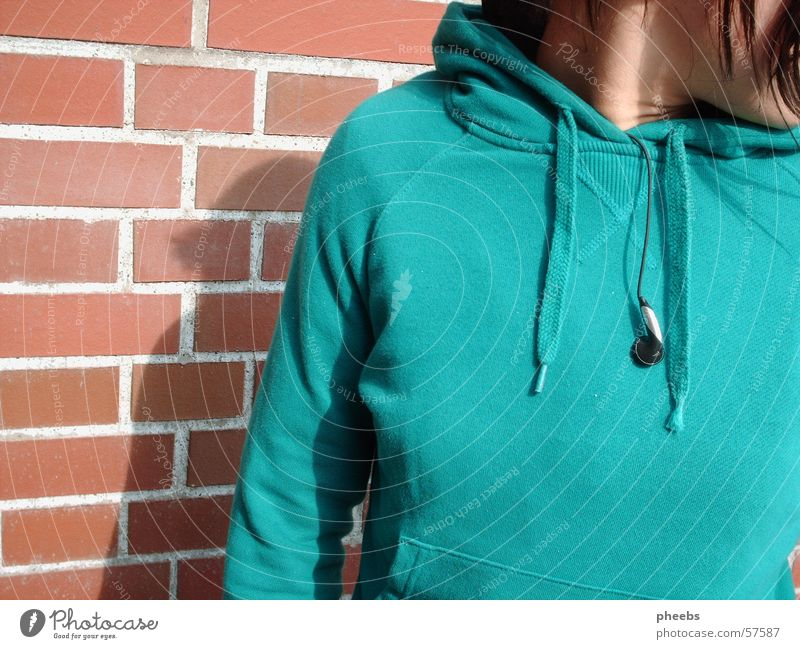 vital music? Woman Sweater Headphones Turquoise Wall (barrier) Brick Light Sun Graffiti Hair and hairstyles Neck Music Shadow Partially visible Detail