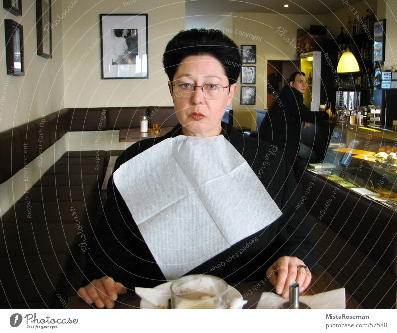 Madame spills ... 50 plus Woman Sidewalk café Bar Breakfast Bib Senior citizen Village Morning Eyeglasses Café Piqued Playing Humor Gastronomy Joy served