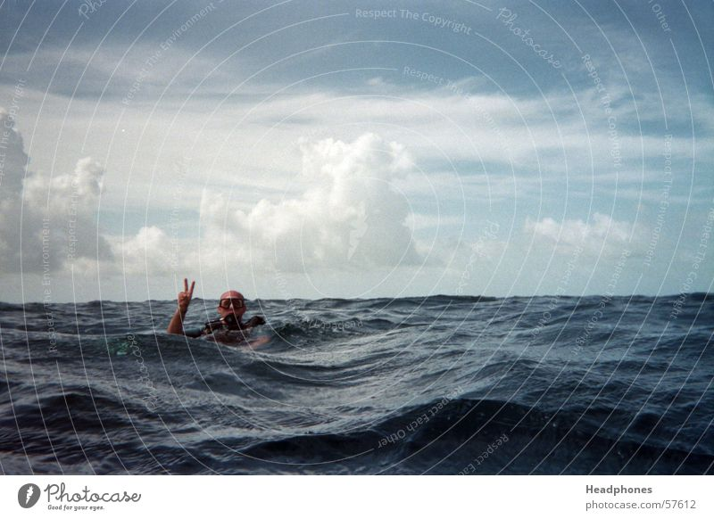 Human being Man Blue Water Ocean Loneliness Clouds Adults Waves Fear Masculine Dive Analog Thunder and lightning Maldives Storm clouds