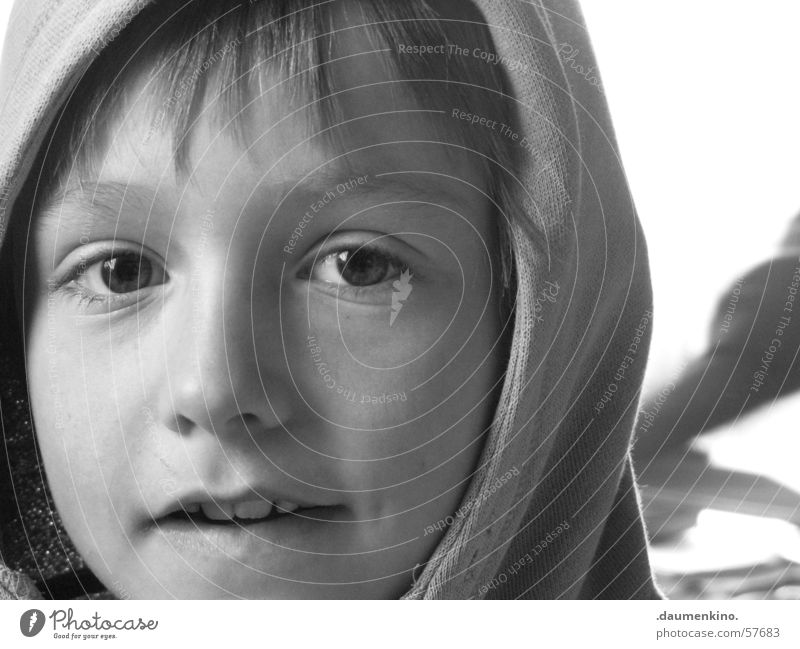 Child White Face Black Eyes Boy (child) Window Hair and hairstyles Mouth Nose Teeth Lips Sweater Hooded (clothing) Forehead