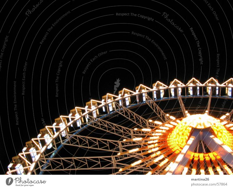 centrifuges Ferris wheel Fairs & Carnivals Light Night Yellow Red Leisure and hobbies Theme-park rides Joy Exterior shot Illumination Carousel Neon light