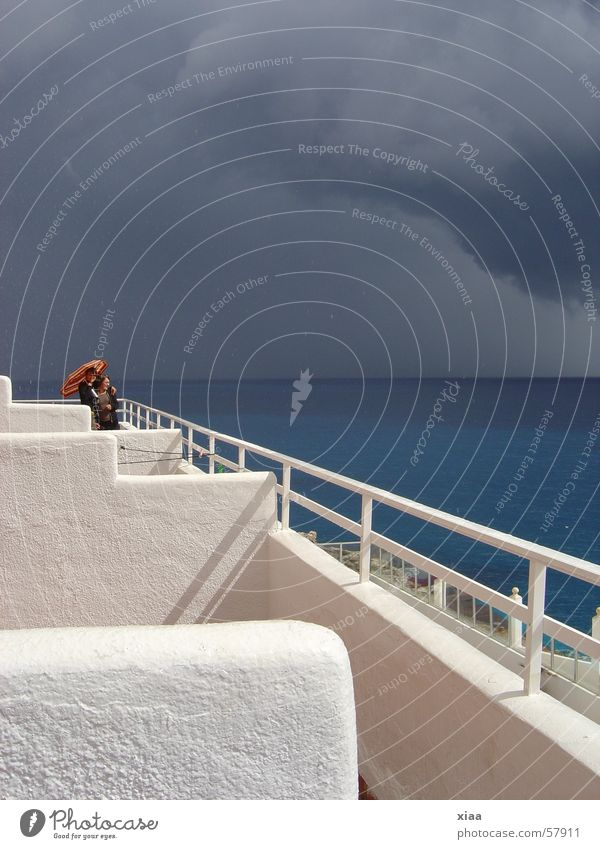 Sky Sun Ocean Vacation & Travel Clouds Dark Umbrella Gale Balcony Thunder and lightning Spain Handrail Majorca