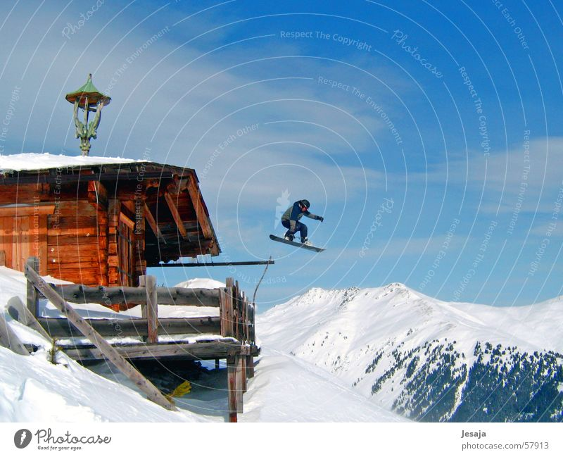 ski-bound Snowboard Winter Jump Ski hut Vacation & Travel Wooden hut Austria Snowboarder Hut Mountain Alps Tall Snowboarding Crazy far Roof Wooden house
