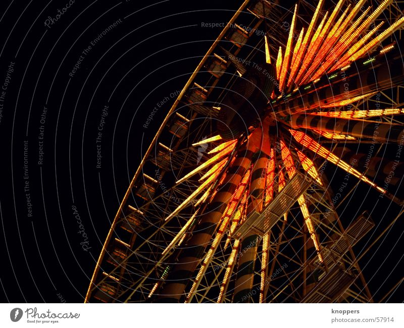 Ferris wheel at night. Second. Theme-park rides Festival Shooting match Amusement Park Holy Synod Night Dark Light Romance Exterior shot Visual spectacle fair