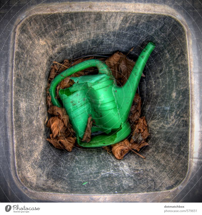 Rejected Garden Leaf Watering can Plastic Old Dirty Broken Gray Green Black Trade Decline Transience Destruction Colour photo Exterior shot Close-up Deserted