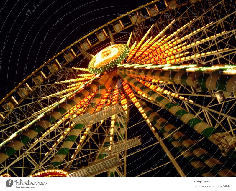 Ferris wheel at night. Third. Theme-park rides Festival Shooting match Amusement Park Holy Synod Night Dark Light Romance Exterior shot Visual spectacle fair