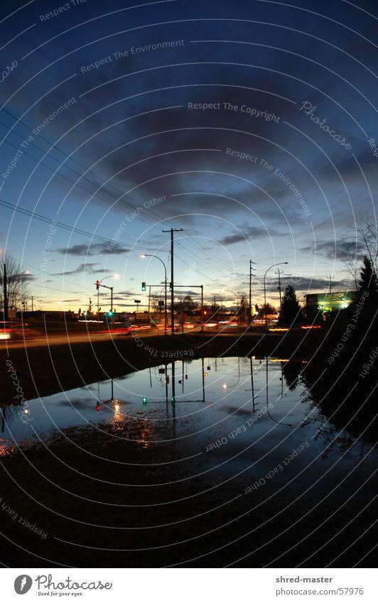 Traffic in NorthVan Transport Reflection Puddle Sunset