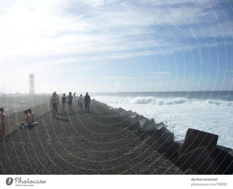 Human being Ocean Coast Lake Waves Wind Fog Concrete To go for a walk Gale Jetty Surf White crest Dike Swell Tenerife