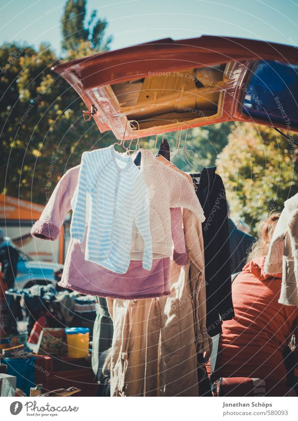 used clothes hangs on car at the flea market Lifestyle Style Fashion Clothing T-shirt Shirt Sweater Jacket Coat Hip & trendy Uniqueness Flea market Sell Stall