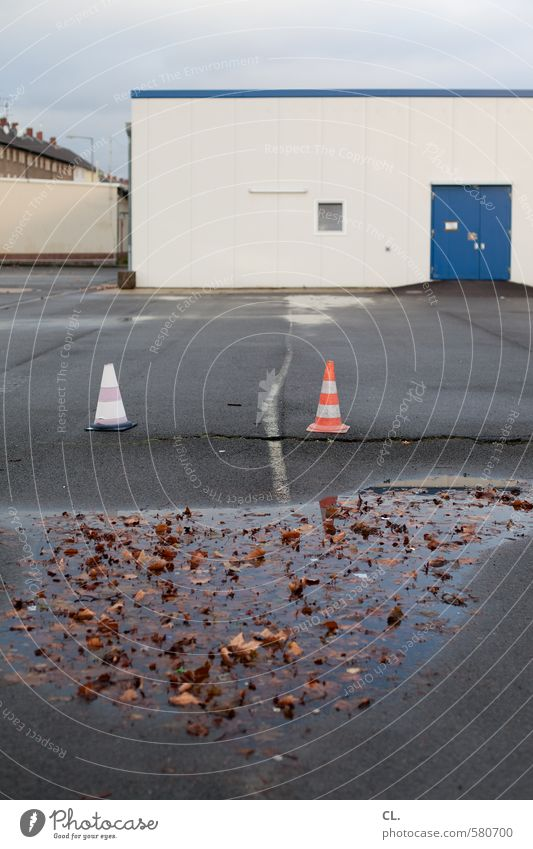 ut pascha | parking, puddles + pylons Sky Autumn Bad weather Rain Leaf Industrial plant Factory Places Building Door Wet Gloomy Stagnating Puddle Traffic cone
