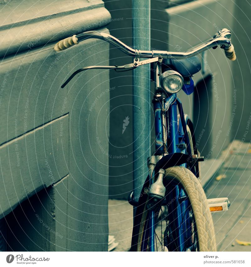 radnostalgia Transport Means of transport Road traffic Cycling Street Bicycle Old Retro Town Blue Nostalgia Logistics Colour photo Exterior shot Deserted Day