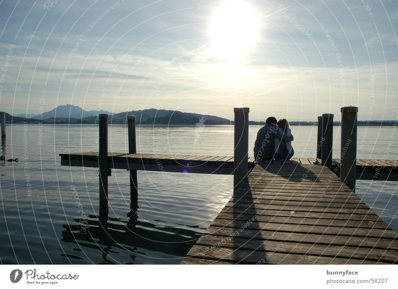 Water Sun Blue Calm Love Loneliness Far-off places Emotions Lake Friendship Together Coast Footbridge To enjoy Deep Relationship