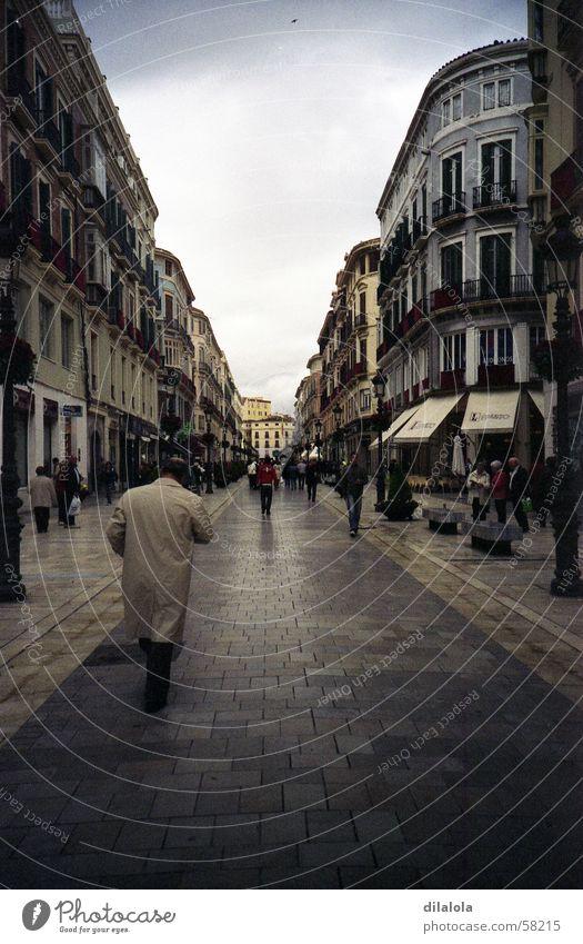 el hombre de la gabardina beige Town Malaga Winter Lomography Grief Distress street lonely rain gray man spain village cold alone rainy
