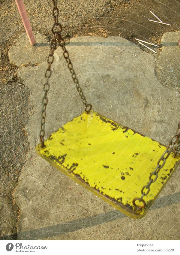 one Swing Playground Concrete yellow- pink Chain Loneliness