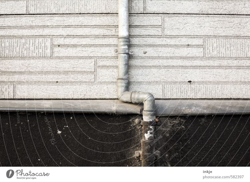 rain pipe Deserted Manmade structures Wall (barrier) Wall (building) Facade Downpipe Thin Long Gray Black Broken Downward Vertical Colour photo Subdued colour