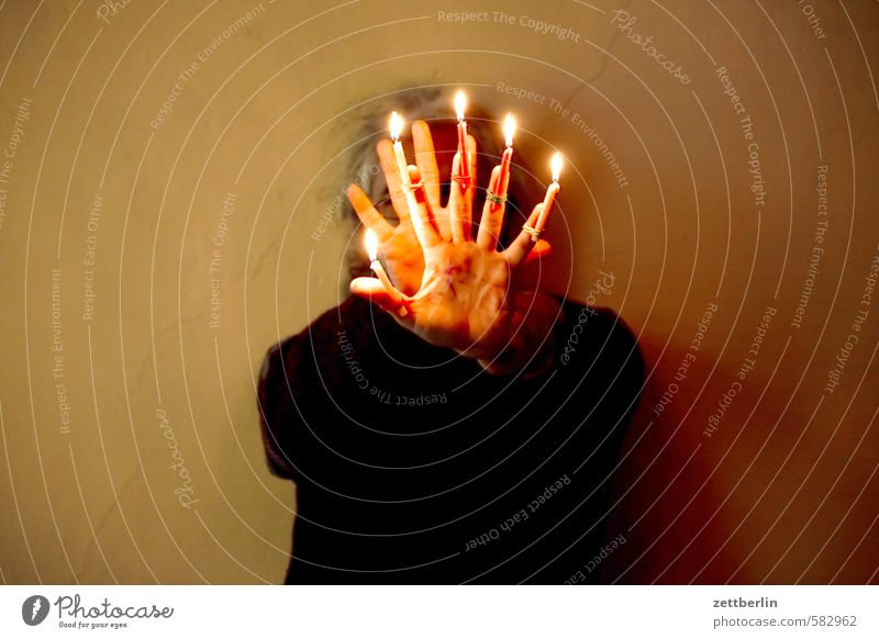 Christmas anticipation Christmas & Advent Flame Candle Candlelight Lighting Illuminate wallroth Anti-Christmas Human being Head Hand Fingers 5 Defensive