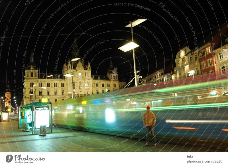rush hour Long exposure Light Tram Driving Railroad tracks Main square Graz Night Man Stand Building Historic Movement Lighting Lamp Station Wait